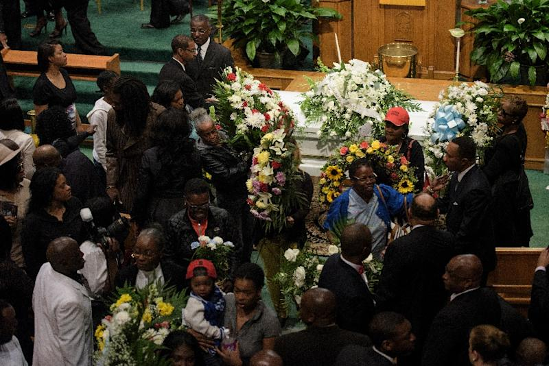 People depart after Freddie Gray's funeral at New Shiloh Baptist Church in Baltimore, Maryland, on April 27, 2015 (AFP Photo/Brendan Smialowski)