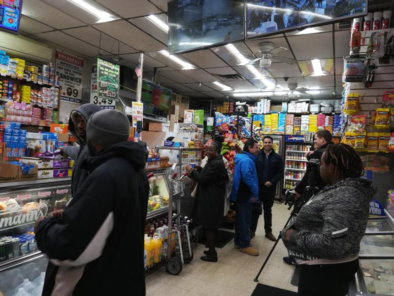 People are shown inside the West Harlem Deli, Sunday, Oct. 28, 2018, in New York. One of two Powerball tickets that hit the $688 million jackpot was sold at the store. (AP Photo/Julie Walker)