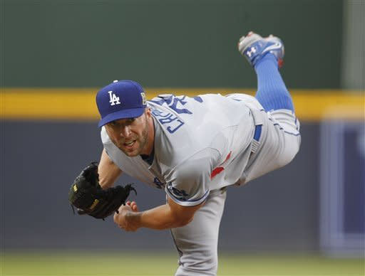 Los Angeles Dodgers starting pitcher Chris Capuano works in the first inning of a baseball game against the Atlanta Braves, Friday, Aug. 17, 2012, in Atlanta. (AP Photo/John Bazemore)