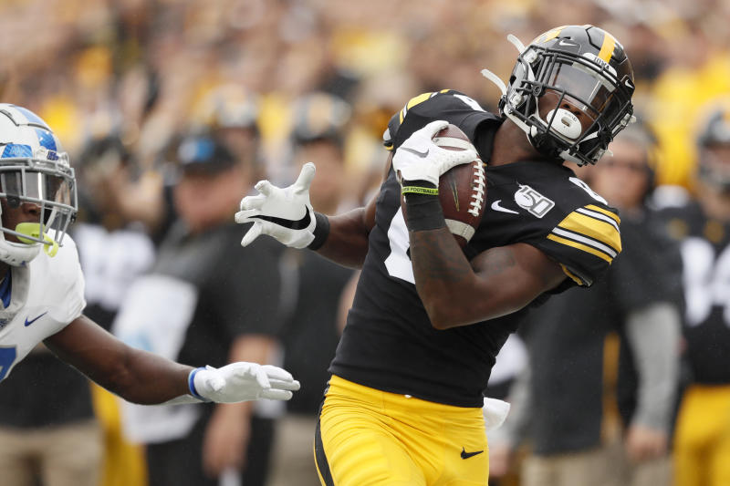 Iowa wide receiver Ihmir Smith-Marsette catches a pass ahead of Middle Tennessee cornerback Teldrick Ross, left, during the first half of an NCAA college football game, Saturday, Sept. 28, 2019, in Iowa City, Iowa. (AP Photo/Charlie Neibergall)