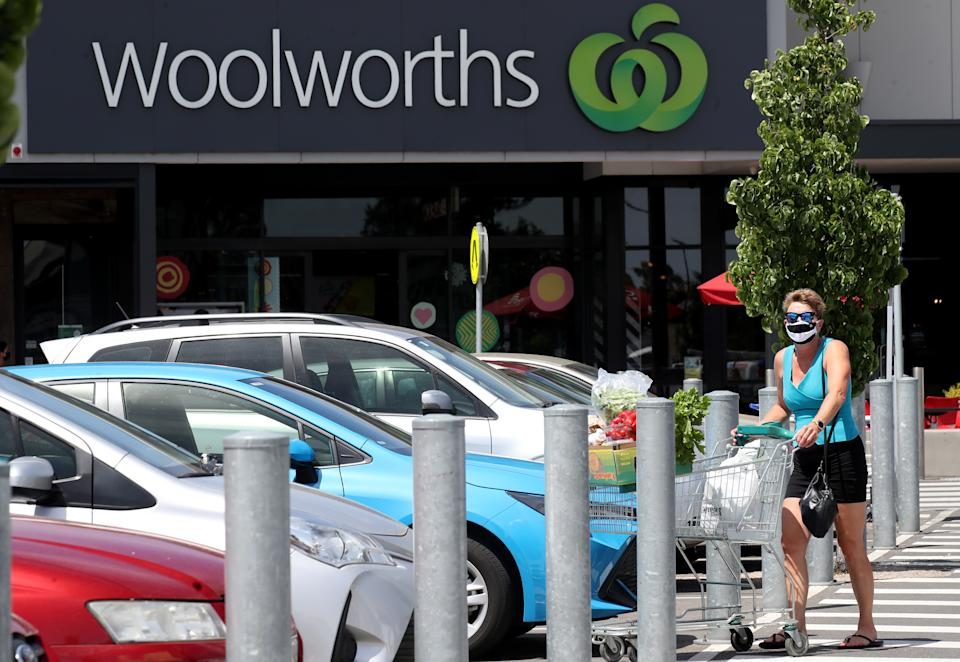 Woman pushing trolley in a car park outside Woolworths. Source: Getty Images