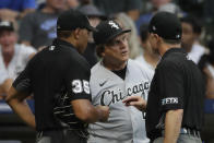 Chicago White Sox's Tony La Russa, center, reacts as he talks with umpires during the fifth inning of a baseball game against the Milwaukee Brewers, Saturday, July 24, 2021, in Milwaukee. (AP Photo/Aaron Gash)