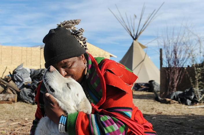 <p>Dan Nanamkin from the Nez Perce tribe hugs his dog during a protest against the Dakota Access pipeline near the Standing Rock Indian Reservation near Cannon Ball, North Dakota, U.S. November 13, 2016. (Photo: Stephanie Keith/Reuters) </p>