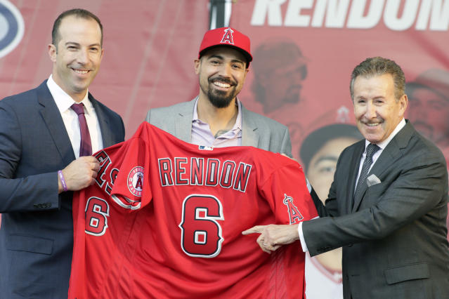 Los Angeles Angels team owner Arte Moreno, right, with general manager Billy Eppler, left, introduce the newest Angel Anthony Rendon, center, with a jersey during a news conference in Anaheim, Calif., Saturday, Dec. 14, 2019. Anthony Rendon and the Los Angeles Angels agreed to a $245 million, seven-year contract earlier in the week. (AP Photo/Alex Gallardo)