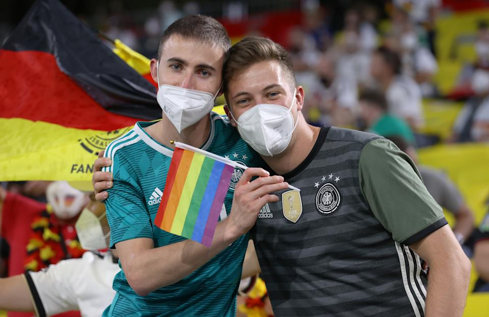 MUNICH, GERMANY - JUNE 23: Fans of Germany hold a rainbow flag prior to the UEFA Euro 2020 Championship Group F match between Germany and Hungary at Allianz Arena on June 23, 2021 in Munich, Germany. (Photo by Alex Grimm - UEFA/UEFA via Getty Images)