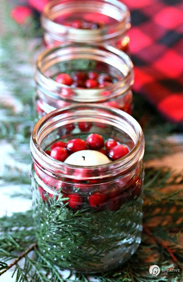 """<p>In just five minutes, you can create these stunning luminaries using jars (Mason jars are our pick, but pickle jars work just as well), cranberries, cedar clippings or something green, and floating candles. </p><p><strong>Get the tutorial at <a href=""""http://todayscreativelife.com/5-minute-diy-christmas-luminaries/"""" rel=""""nofollow noopener"""" target=""""_blank"""" data-ylk=""""slk:Today's Creative Life"""" class=""""link rapid-noclick-resp"""">Today's Creative Life</a>.</strong></p><p><a href=""""https://www.amazon.com/s?url=search-alias%3Dgarden&field-keywords=mason+jars"""" rel=""""nofollow noopener"""" target=""""_blank"""" data-ylk=""""slk:SHOP MASON JARS"""" class=""""link rapid-noclick-resp"""">SHOP MASON JARS</a></p>"""