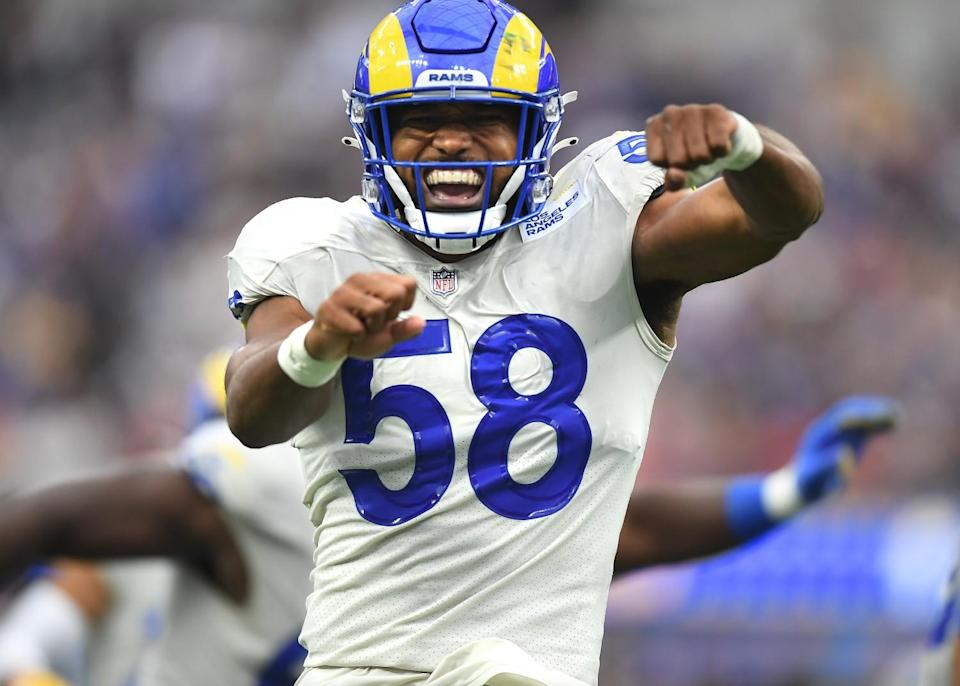 Rams linebacker Justin Hollins celebrates after stopping the Buccaneers on third down.