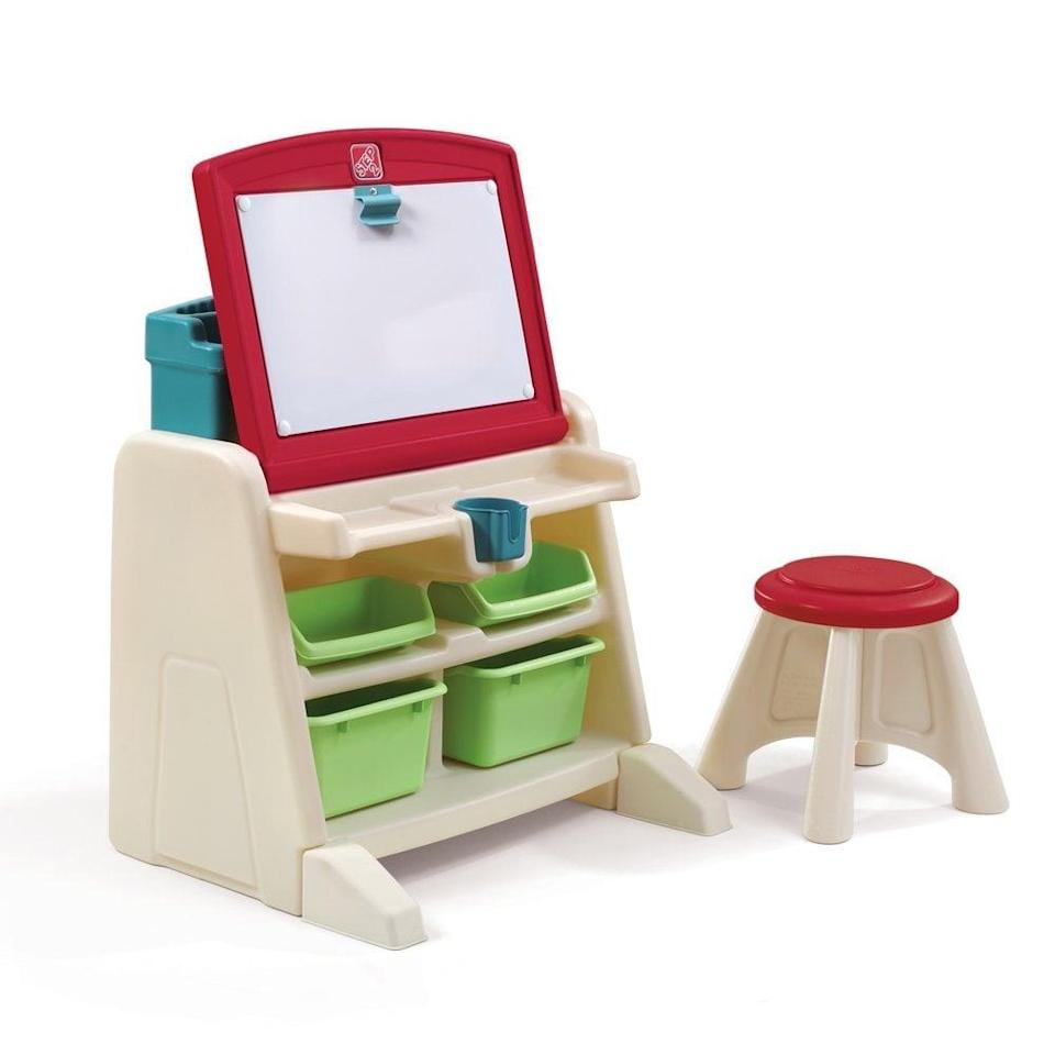 "<p>The Step2 Company's <a href=""https://www.popsugar.com/buy/Flip-Doodle-Desk-Stool-Easel-398619?p_name=Flip%20and%20Doodle%20Desk%20With%20Stool%20Easel&retailer=walmart.com&pid=398619&price=55&evar1=moms%3Aus&evar9=25800161&evar98=https%3A%2F%2Fwww.popsugar.com%2Fphoto-gallery%2F25800161%2Fimage%2F32356677%2FStep2-Company-Flip-Doodle-Desk-Stool-Easel&list1=gifts%2Choliday%2Cgift%20guide%2Cparenting%2Ctoddlers%2Clittle%20kids%2Ckid%20shopping%2Choliday%20living%2Choliday%20for%20kids%2Cgifts%20for%20toddlers%2Cbest%20of%202019&prop13=api&pdata=1"" class=""link rapid-noclick-resp"" rel=""nofollow noopener"" target=""_blank"" data-ylk=""slk:Flip and Doodle Desk With Stool Easel"">Flip and Doodle Desk With Stool Easel</a> ($55) features an upright easel that can fold down into a desktop with a magnetic dry-erase board, trays for markers and pencils, and a cup holder. The set also comes with a matching stool and plenty of storage for books, art supplies, and more.</p>"