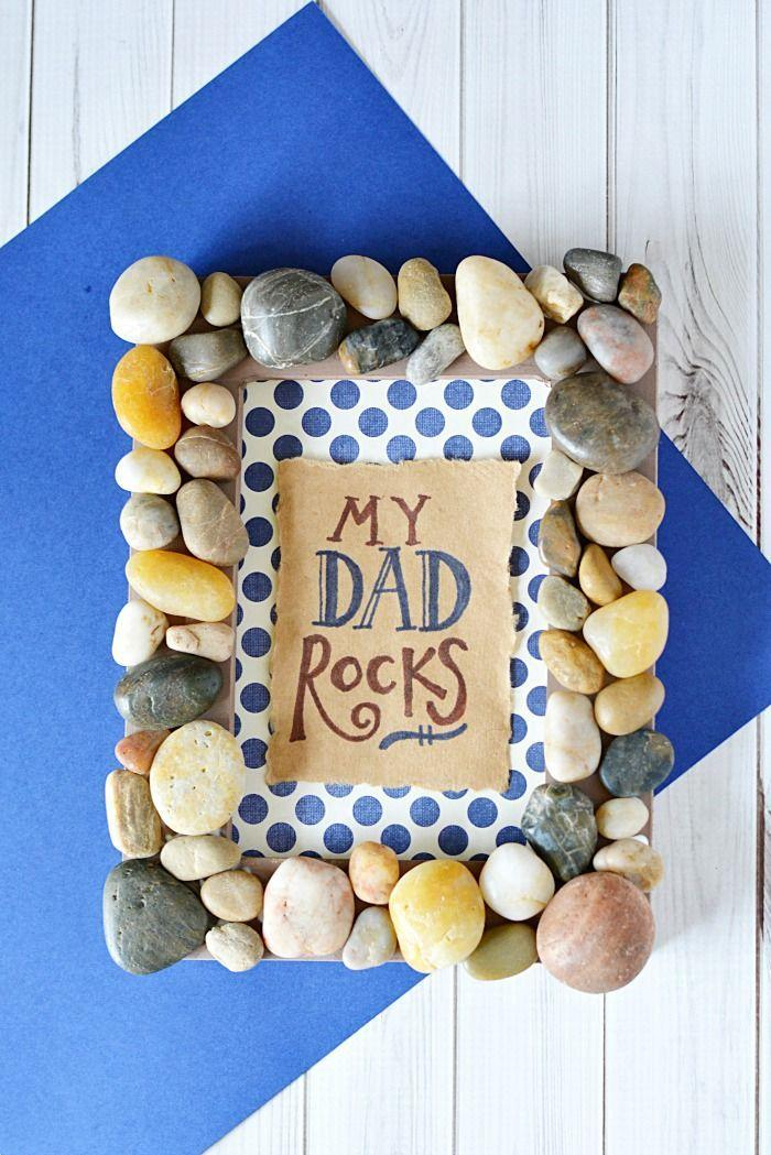 """<p>Rustle up some rocks and you can pull this cute frame together in no time.</p><p><em><strong>Get the tutorial at </strong><strong><a href=""""http://www.mommymoment.ca/2016/05/my-dad-rocks-frame.html"""" rel=""""nofollow noopener"""" target=""""_blank"""" data-ylk=""""slk:Mommy Moment."""" class=""""link rapid-noclick-resp"""">Mommy Moment.</a></strong></em></p><p><strong>RELATED: </strong><a href=""""https://www.womansday.com/relationships/family-friends/g1151/fathers-day-presents/"""" rel=""""nofollow noopener"""" target=""""_blank"""" data-ylk=""""slk:Fantastic Father's Day Presents $50 and Under"""" class=""""link rapid-noclick-resp"""">Fantastic Father's Day Presents $50 and Under</a></p>"""