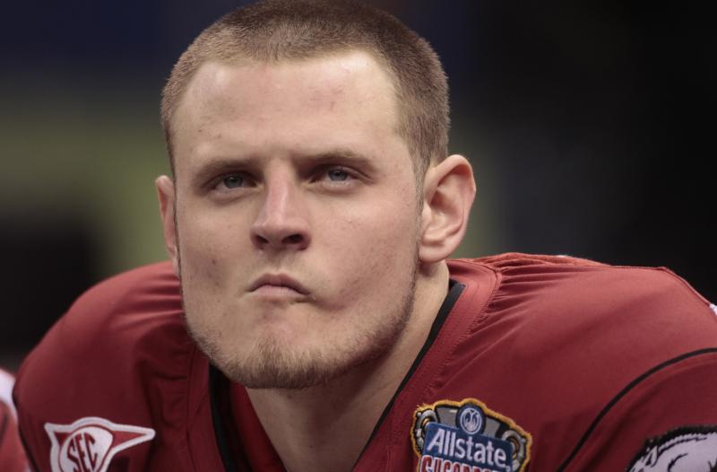 Arkansas quarterback Ryan Mallett watches from the bench near the end of Arkansas' 31-26 loss to Ohio State in the Sugar Bowl NCAA college football game at the Louisiana Superdome in New Orleans, Tuesday, Jan. 4, 2011. (AP Photo/Dave Martin)