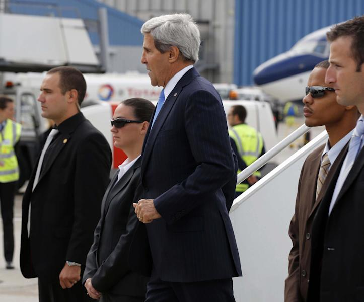U.S. Secretary of State John Kerry, centre, on arrival at Cointrin Airport, in Geneva, Thursday, Sept. 12, 2013, prior to his meeting with Russian Foreign Minister Sergey Lavrov to discuss the ongoing problems in Syria. (AP Photo/Larry Downing, Pool)