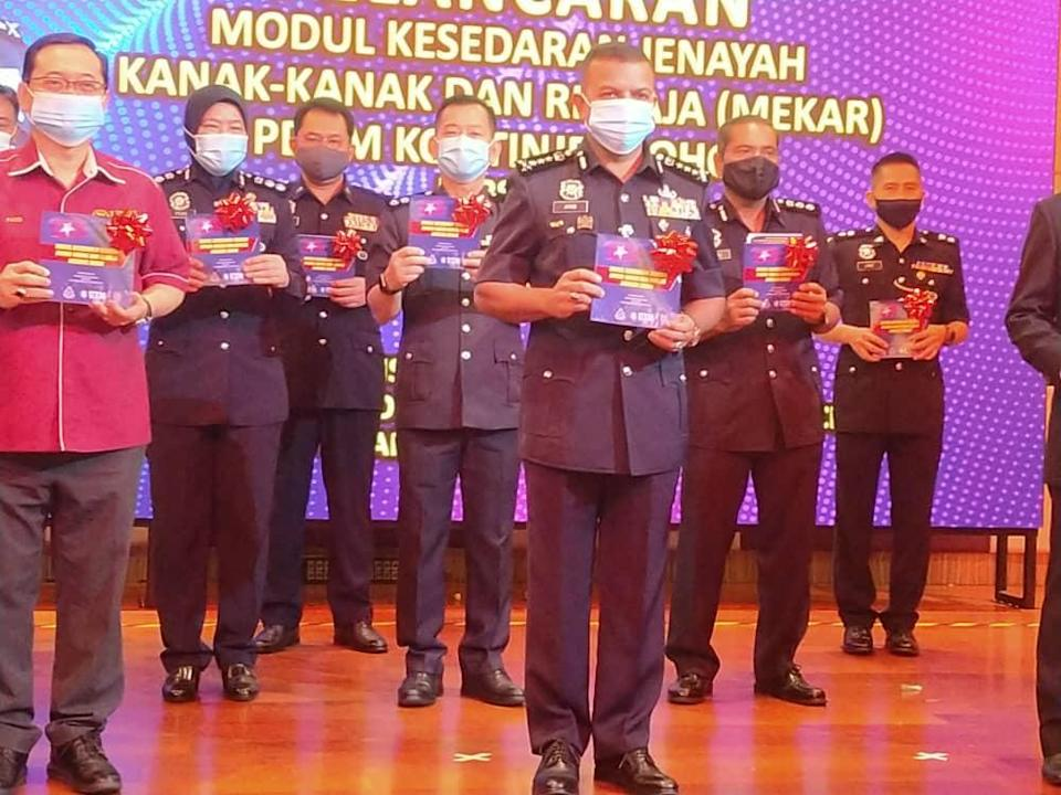 Johor police chief Datuk Ayob Khan Mydin Pitchay (front, centre) with the Children and Teenagers Crime Awareness Module which will be implemented in schools and higher learning institutes during its launch in Iskandar Puteri today. — Picture by Ben Tan