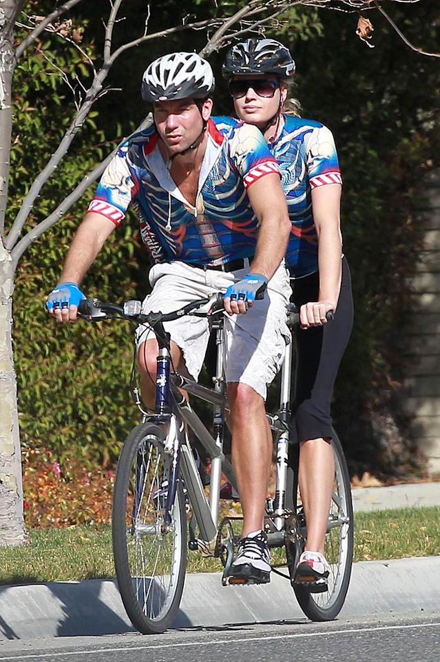 """The couple that rides together, stays together! Jerry O'Connell and wife Rebecca Romijn spent nearly three hours on a bicycle built for two in Los Angeles. But do you think their matching cycling outfits are a little much? Sam Sharma/<a href=""""http://www.pacificcoastnews.com/"""" target=""""new"""">PacificCoastNews.com</a> - January 18, 2011"""