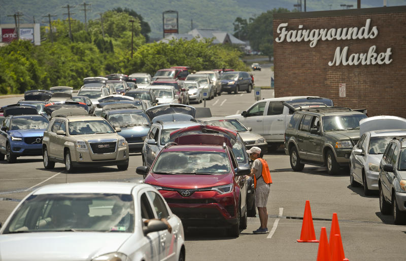 Muhlenberg, PA - June 29: People wait in line in their cars in the parking lot for the Fairgrounds Farmers Market in Muhlenberg township Monday afternoon where Helping Harvest held their pop-up drive through food distribution June 29, 2020. They have seen an increase in need for food by the community during the coronavirus and the resulting economic slowdown, with their distributions for June this year nearly double what it was last year. (Photo by Ben Hasty/MediaNews Group/Reading Eagle via Getty Images)