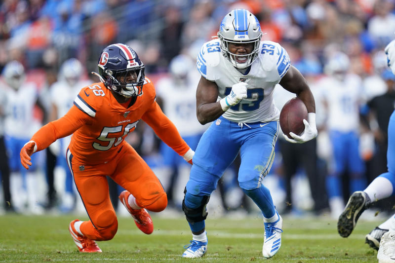 Detroit Lions running back Kerryon Johnson (33) runs as Denver Broncos outside linebacker Von Miller (58) pursues during the second half of an NFL football game, Sunday, Dec. 22, 2019, in Denver. (AP Photo/Jack Dempsey)