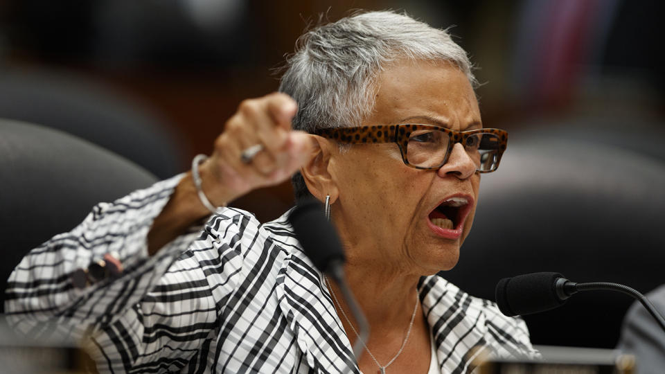 Rep. Bonnie Watson Coleman points while speaking into a microphone