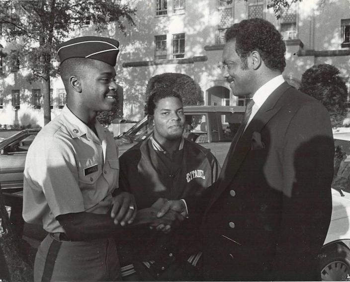 """Ken Gordon, left, introduces himself to civil rights leader and Greenville, S.C. native the Rev. Jesse Jackson, right, in the fall of 1986. Jackson and other Black leaders descended on Charleston in support of Kevin Nesmith, a Black cadet who resigned following an Oct. 23, 1986 racial hazing incident. Gordon said Jackson later pulled him aside, gave him his personal phone number and told him, """"I can't stay here, but I'm always going to be here for you."""""""