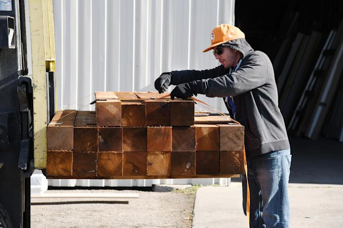 Image: Lumber is transported in Colorado (Hyoung Chang / Denver Post via Getty Images file)