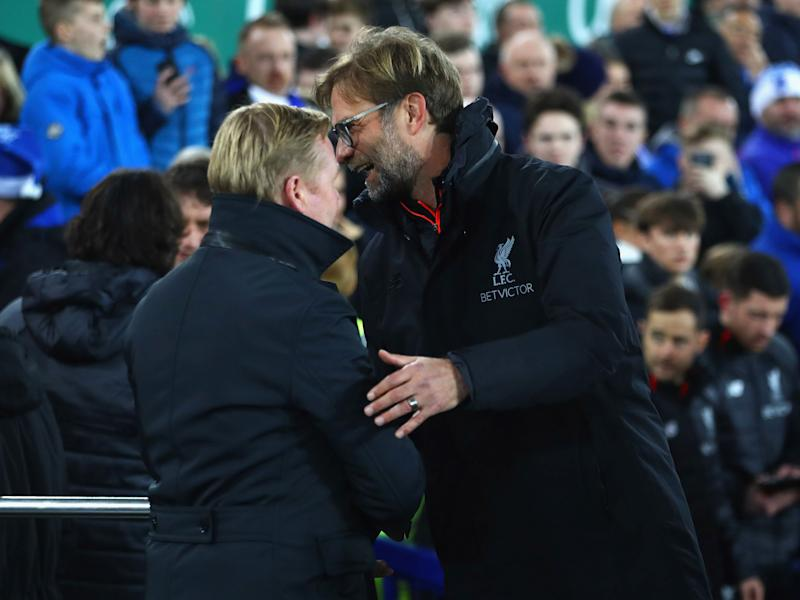Klopp and Koeman embrace during this season's first Merseyside derby at Goodison Park: Getty
