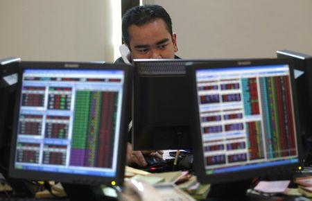 Stocks tumble; emerging markets hit as dollar rises, yuan falls