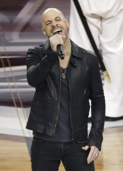 Chris Daughtry sings the national anthem before an NCAA Final Four tournament college basketball semifinal game between Florida and Connecticut, Saturday, April 5, 2014, in Arlington, Texas. (AP Photo/Tony Gutierrez)