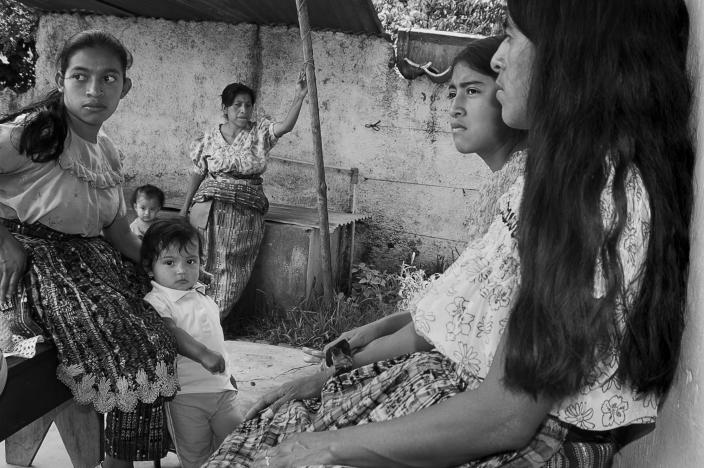 <p>Villagers waiting to be seen by a healer in San Pedro la Laguna, Guatemala. (Photograph by Fran Antmann) </p>