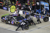 Kevin Harvick makes a pit stop during the NASCAR Cup Series auto race at Richmond Raceway in Richmond, Va., Saturday, Sept. 21, 2019. (AP Photo/Steve Helber)