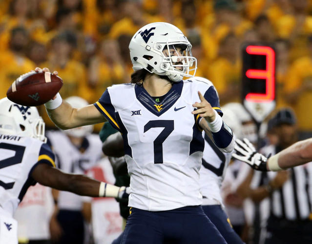 FILE - In this Oct. 21, 2017, file photo, West Virginia quarterback Will Grier (7) passes in the first half of an NCAA college football game against West Virginia, in Waco, Texas. While several Big 12 teams are unsettled on a starting quarterback, West Virginia gets back Will Grier after he broke the middle finger on his throwing hand late last season. (AP Photo/Jerry Larson, File)