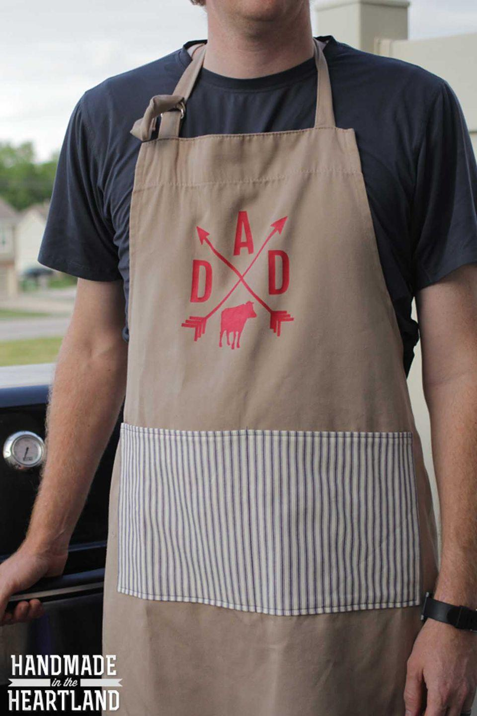 """<p>Dad can grill in style with this spiffy apron. </p><p><em><strong>Get the tutorial at </strong><a href=""""http://www.handmadeintheheartland.com/2014/06/diy-fathers-day-grilllmaster-bbq-apron.html"""" rel=""""nofollow noopener"""" target=""""_blank"""" data-ylk=""""slk:Handmade in the Heartland"""" class=""""link rapid-noclick-resp""""><strong>Handmade in the Heartland</strong></a><strong>. </strong></em></p>"""