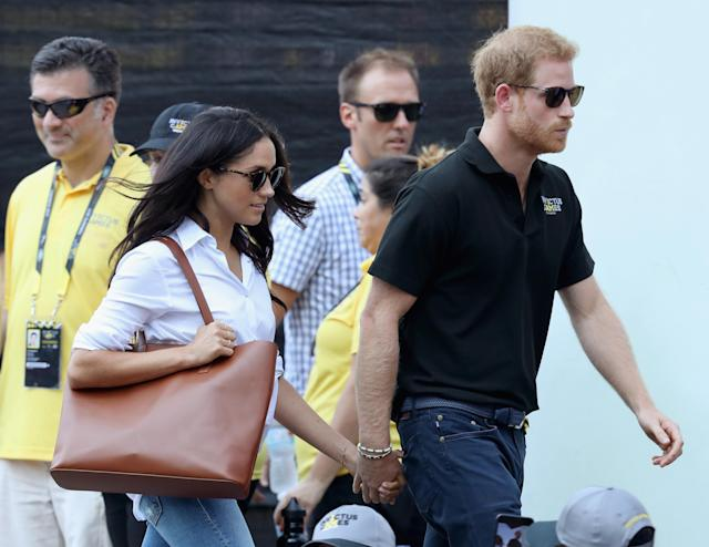 Prince Harry and Meghan Markle at the Invictus Games last fall, clearly in love. (Photo: Getty Images)
