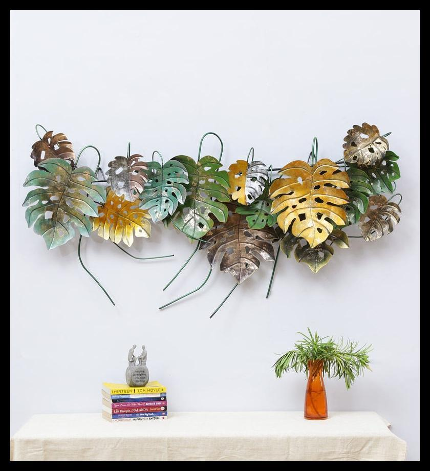 "Punctuate a long passageway with the 57-inch-wide, wrought-iron <a href=""https://fave.co/2MgpEQg"">Multicolour Leaf Panel Wall Hanging</a> by Malik Design. <em>Rs. 6,439 on offer.</em>"