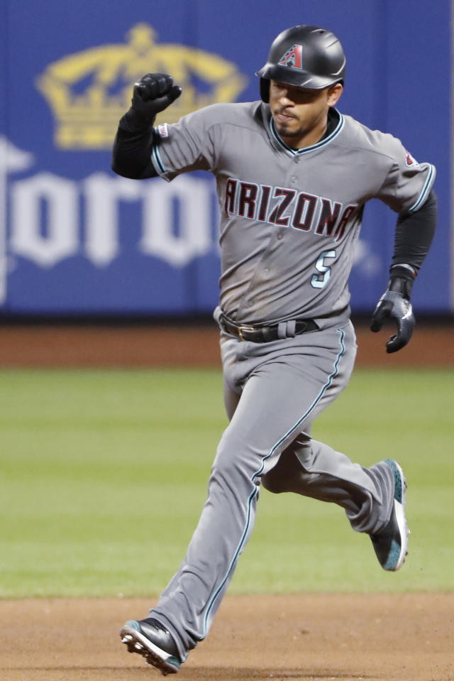 CORRECTS TO EIGHTH INNING, INSTEAD OF SEVENTH - Arizona Diamondbacks' Eduardo Escobar pumps his fist as he runs the bases after hitting a solo home run during the eighth inning of the team's baseball game against the New York Mets, Tuesday, Sept. 10, 2019, in New York. (AP Photo/Kathy Willens)