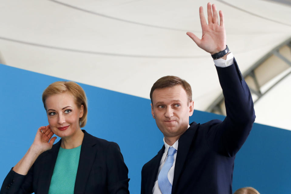 FILE - In this Dec. 24, 2017, file photo, Russian opposition leader Alexei Navalny and his wife Yulia attend a meeting where he was nominated for the presidential election race in Moscow, Russia. Navalny sought to challenge President Vladimir Putin in the 2018 election, but was barred from running by one of his convictions. Navalny is an anti-corruption campaigner and the Kremlin's fiercest critic. (AP Photo/Pavel Golovkin, File)