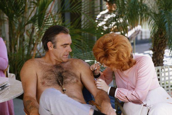 <p>Scottish actor Sean Connery wasn't shy when going shirtless on the set of <em>Diamonds Are Forever</em> in 1971. <em>He </em>lounged shirtless as his costar, Jill St. John, drew on his arm.</p>