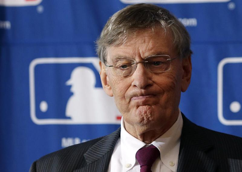FILE - In this Aug. 15, 2013, file photo, Major League Baseball Commissioner Bud Selig grimaces during a news conference following baseball meetings at the Otesaga Hotel in Cooperstown, N.Y. (AP Photo/Mike Groll, File)