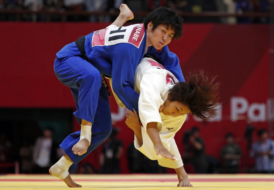 Judo - 2018 Asian Games - Women's -63kg, Gold Medal Match - JCC Plenary Hall, Jakarta, Indonesia - August 30, 2018 - Nami Nabekura of Japan and Kiyomi Watanabe of the Philippines in action. REUTERS/Issei Kato