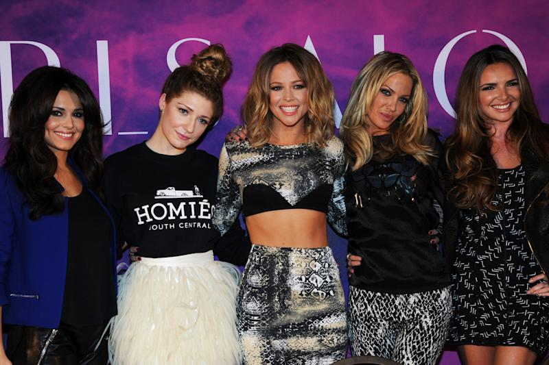 LONDON, ENGLAND - OCTOBER 19: (L-R) Cheryl Cole, Nicola Roberts, Kimberley Walsh, Sarah Harding and Nadine Coyle of Girls Aloud pose at a press conference to announce 'Girls Aloud Ten, The Hits Tour 2013' at The Corinthia Hotel on October 19, 2012 in London, England. (Photo by Dave J Hogan/Getty Images)