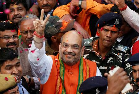 Amit Shah (C) president of India's ruling Bharatiya Janata Party (BJP) gestures as he celebrates with party supporters after learning of the initial poll results inside the party headquarters in New Delhi, India, March 11, 2017. REUTERS/Adnan Abidi