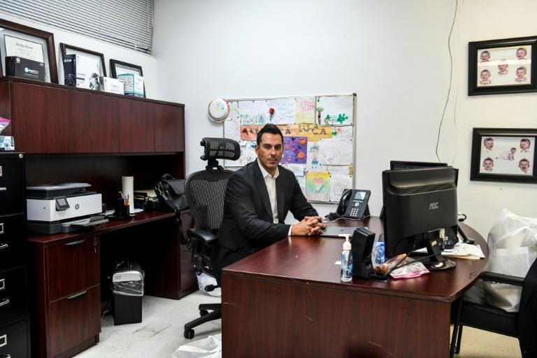 Vice president of DemeTech Luis Arguello poses in his office at a family-owned medical equipment factory in north Miami, Florida on February 15, 2021