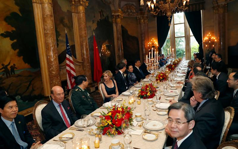 Donald Trump sits down to dinner after giving the order to bomb a Syrian air base - AP