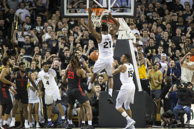 Central Florida forward Chad Brown (21) slams the ball home during the first half of an NCAA college basketball game against Houston in Orlando, Fla., Thursday, Feb. 7, 2019. (AP Photo/Willie J. Allen Jr.)