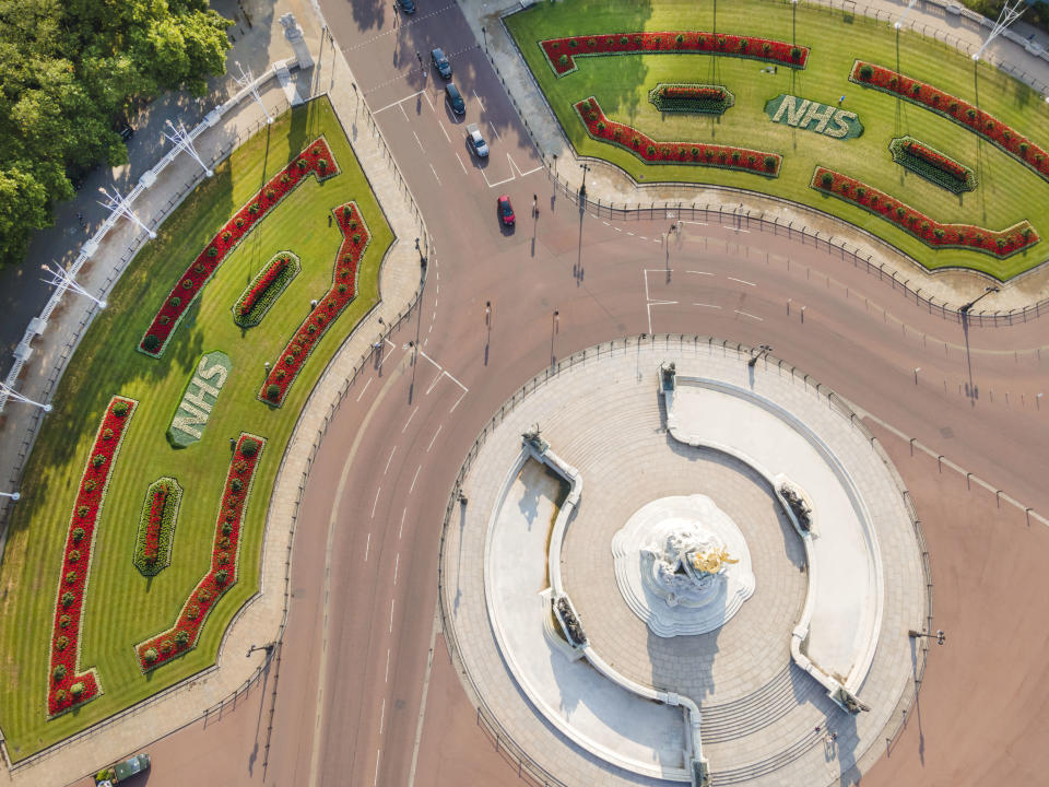 An aerial view of two specially created 12 x 5 metre flowerbeds in front of Buckingham Palace in the Memorial Gardens in St James's Park as a tribute to the 72nd anniversary of the NHS. The letters are made up of 1,500 Begonia semperflorens 'Heaven White' plants in each bed, while the background is 21,000 plants of Echeveria imbricate, Senecio serpens and Sedum pachyclados.