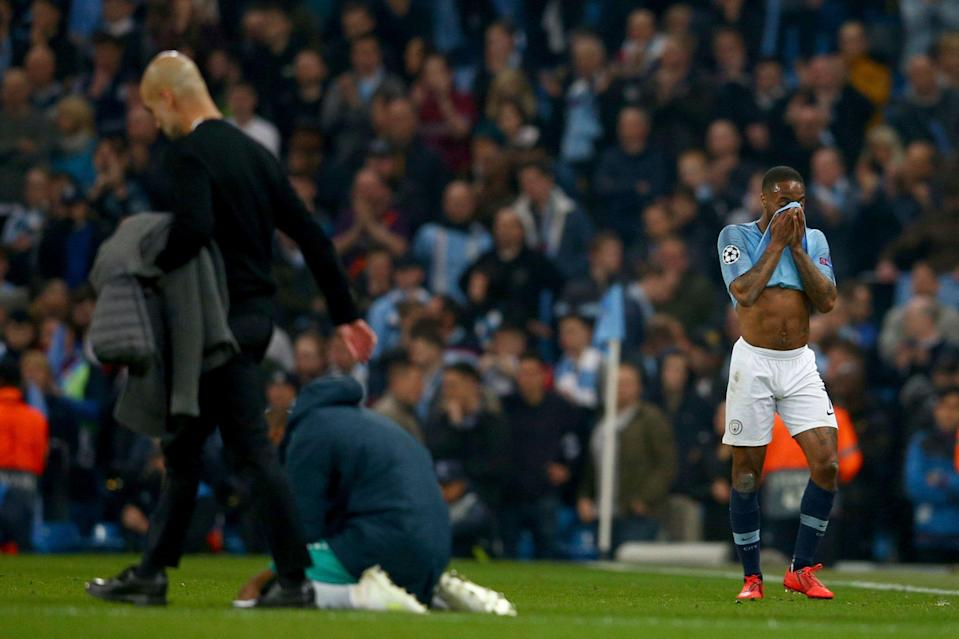 Manchester City's Raheem Sterling, right, and Manchester City coach Pep Guardiola, left, react after being defeated in the Champions League quarterfinal, second leg, soccer match between Manchester City and Tottenham Hotspur at the Etihad Stadium in Manchester, England, Wednesday, April 17, 2019. (AP Photo/Dave Thompson)