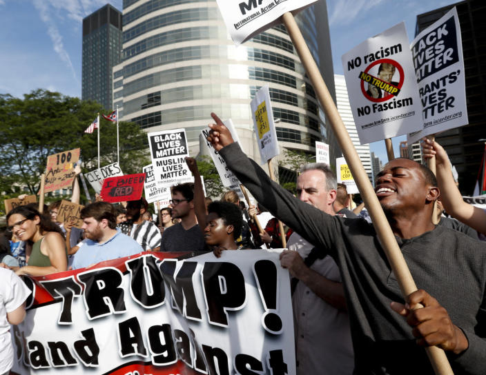 <p>Demonstrators yell during the Shut Down Trump and the RNC protest on Sunday, July 17, 2016, in Cleveland, Ohio. (Photo: Alex Brandon/AP)</p>