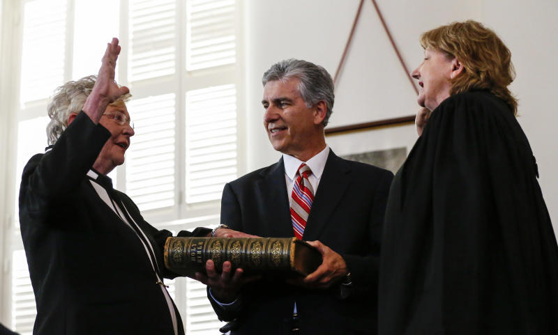 Kay Ivey, left, takes the oath of office as Governor of Alabama as she is sworn in by Acting Chief Justice, Lyn Stuart, Monday, April 10, 2017, in Montgomery, Ala. (AP Photo/Butch Dill)