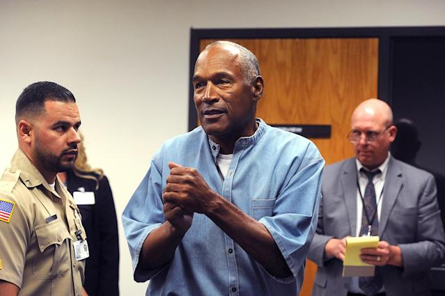 <p>O.J. Simpson (center) reacts during his parole hearing at Lovelock Correctional Centre in Lovelock, Nevada, U.S. July 20, 2017. REUTERS/Jason Bean/POOL </p>
