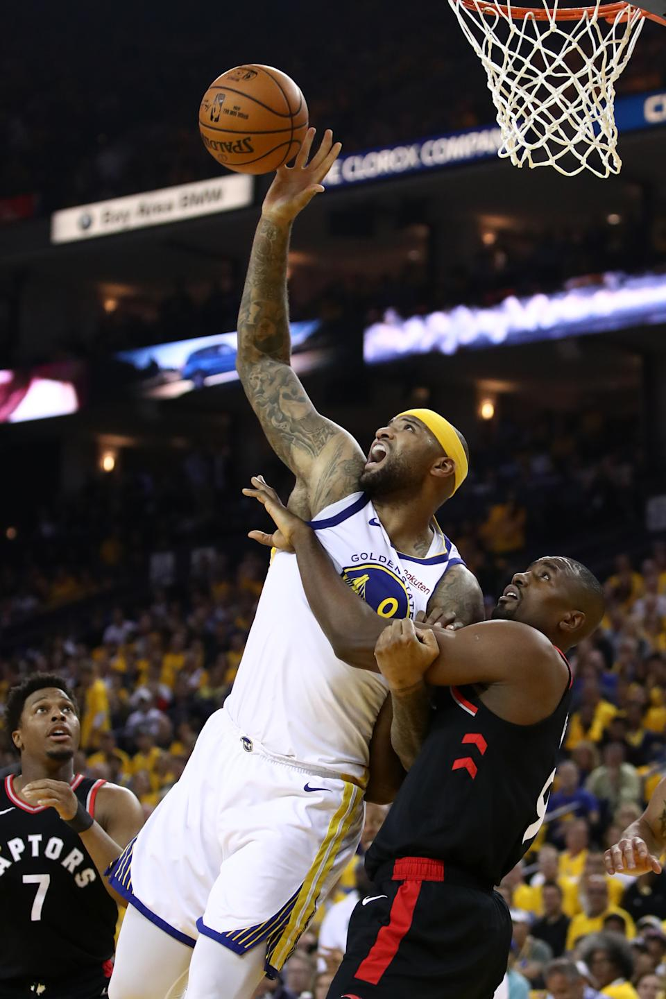 DeMarcus Cousins #0 of the Golden State Warriors attempts to control the ball against the Toronto Raptors in the first half during Game Three of the 2019 NBA Finals at ORACLE Arena on June 05, 2019 in Oakland, California. (Photo by Ezra Shaw/Getty Images)