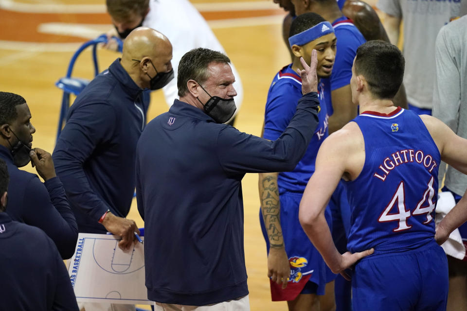 Kansas head coach Bill Self, center, has his team on a nice roll the past few weeks. (AP Photo/Eric Gay)