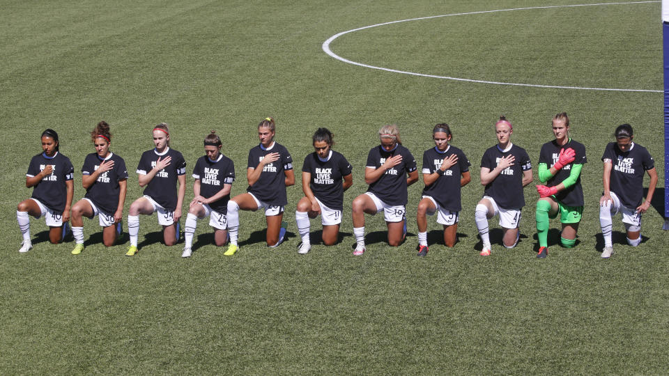 Players for the Portland Thorns kneel during the national anthem before the start of their NWSL Challenge Cup soccer match against the North Carolina Courage at Zions Bank Stadium Saturday, June 27, 2020, in Herriman, Utah. (AP/Rick Bowmer)