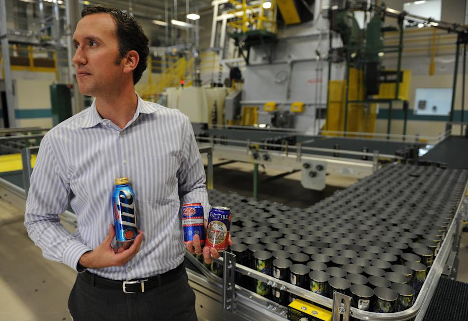 Dan Vorlage, of Ball Corporation, holds cans, Tuesday Oct. 11, 2011, at Ball Corporation in Westminster that are part of the new aluminum can look for the company. RJ Sangosti, The Denver Post  (Photo By RJ Sangosti/The Denver Post via Getty Images)
